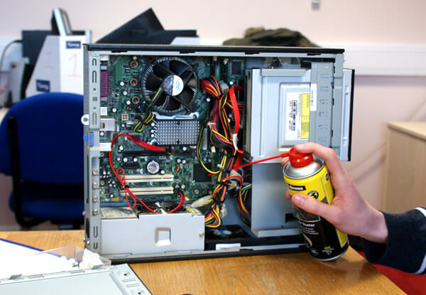 clean a motherboard with compressed air